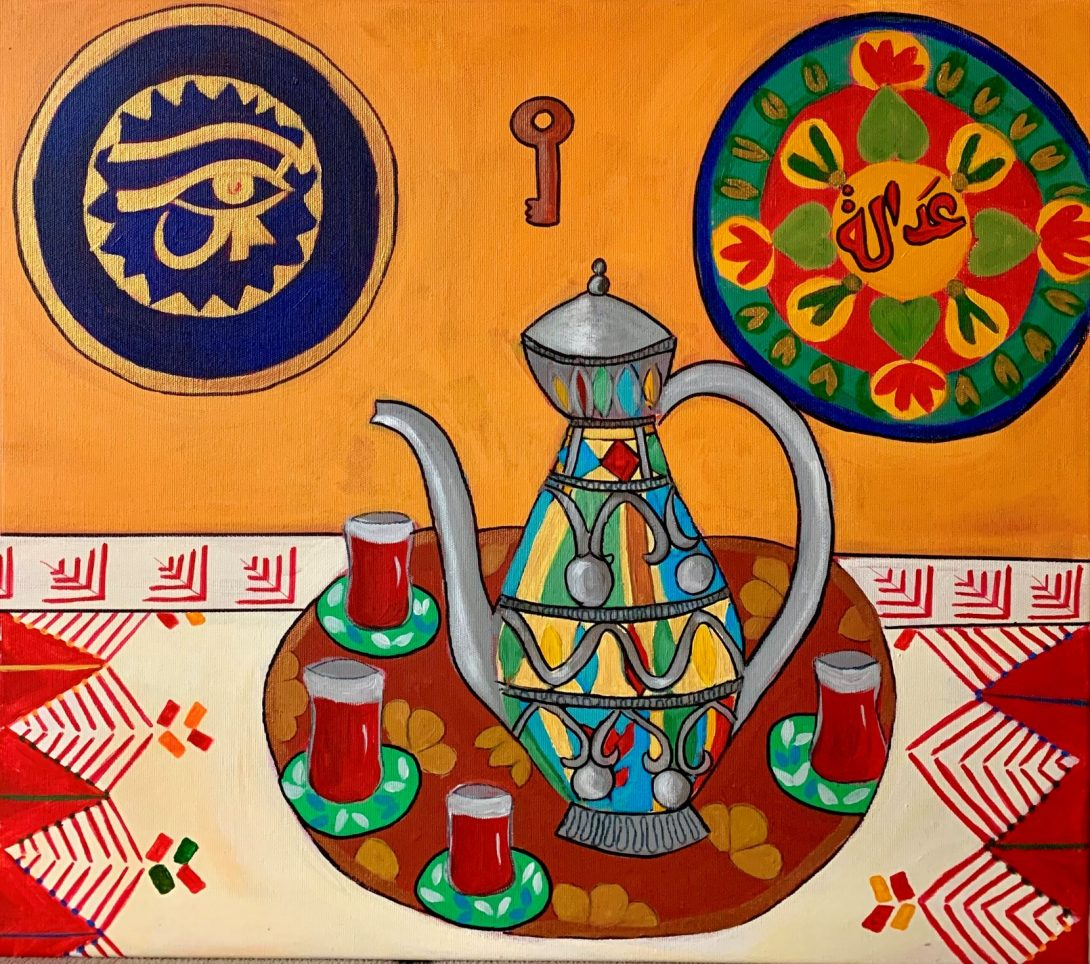Image of a painting with two thirds orange wall that has three hanging items. On the right is an embroidered flowery circular item with Arabic writing in the center. The center hanging is a small key. on the right is a circular plate in blue color with the eye of horus in gold. the bottom third shows an embroidered tablecloth in red, white, green and organce with a decorated tray that has four small tea cups with saucers and a large tea pot engraved in various colors